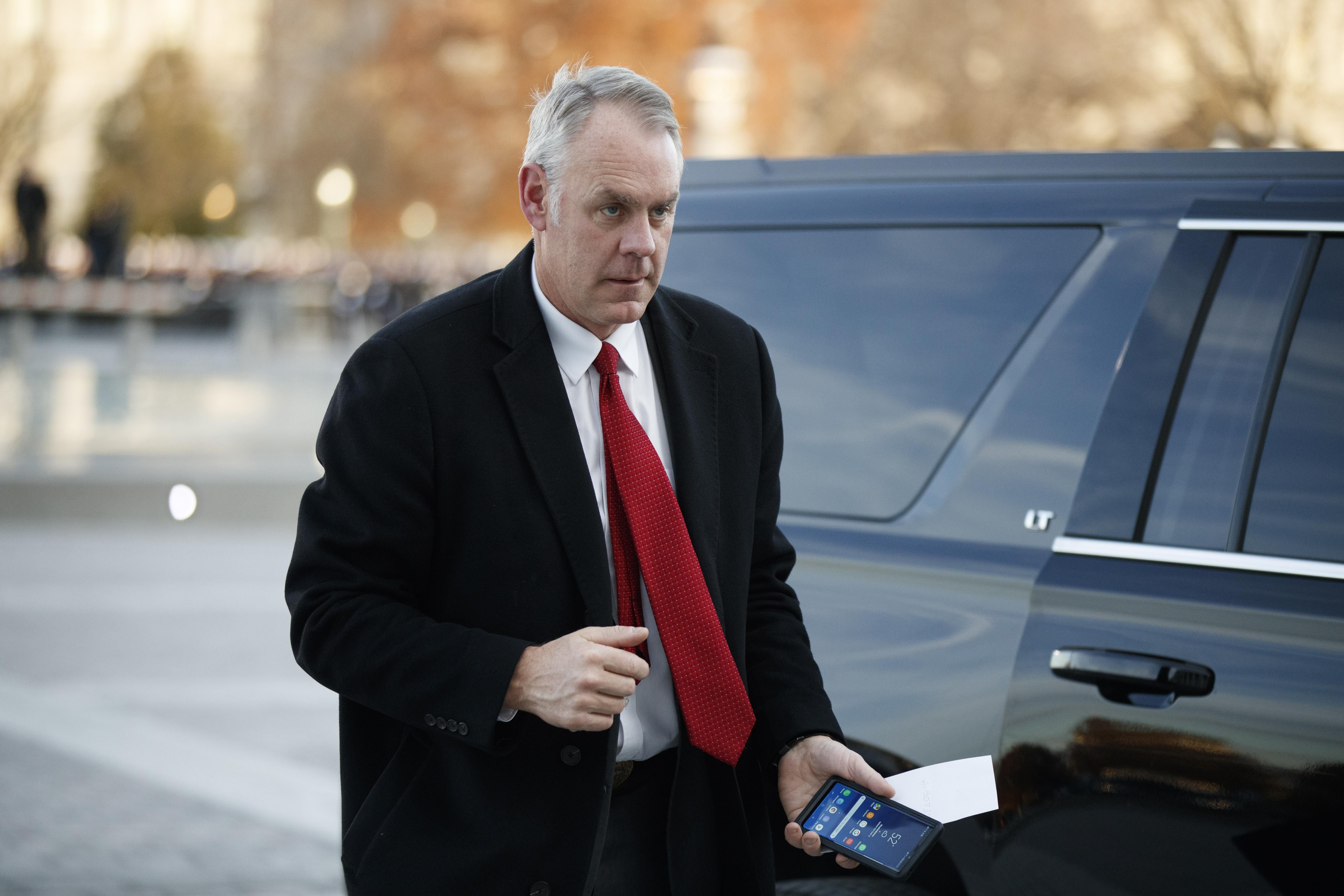 Ryan Zinke exits a car to arrive at the US Capitol on December 03, 2018.