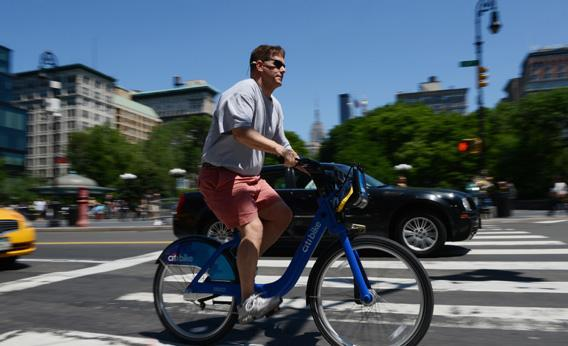 A man rides a Citi Bike bicycle near Union Square as the bike sharing system is launched.