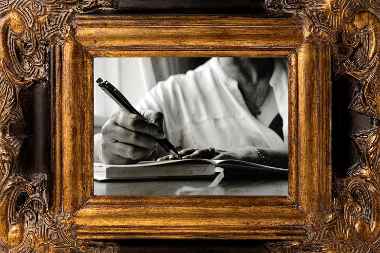 A woman's hand writes in a journal.