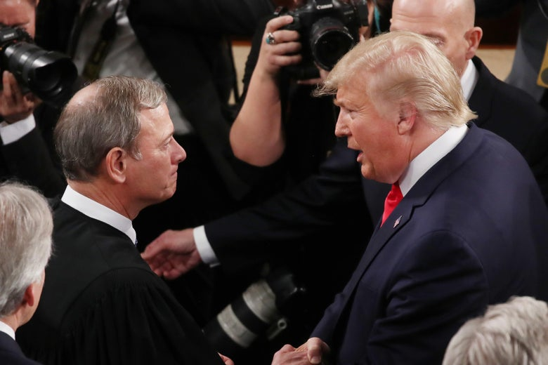 U.S. President Donald Trump speaks to U.S. Supreme Court Chief Justice John Roberts during the State of the Union address in the chamber of the U.S. House of Representatives on February 4, 2020.