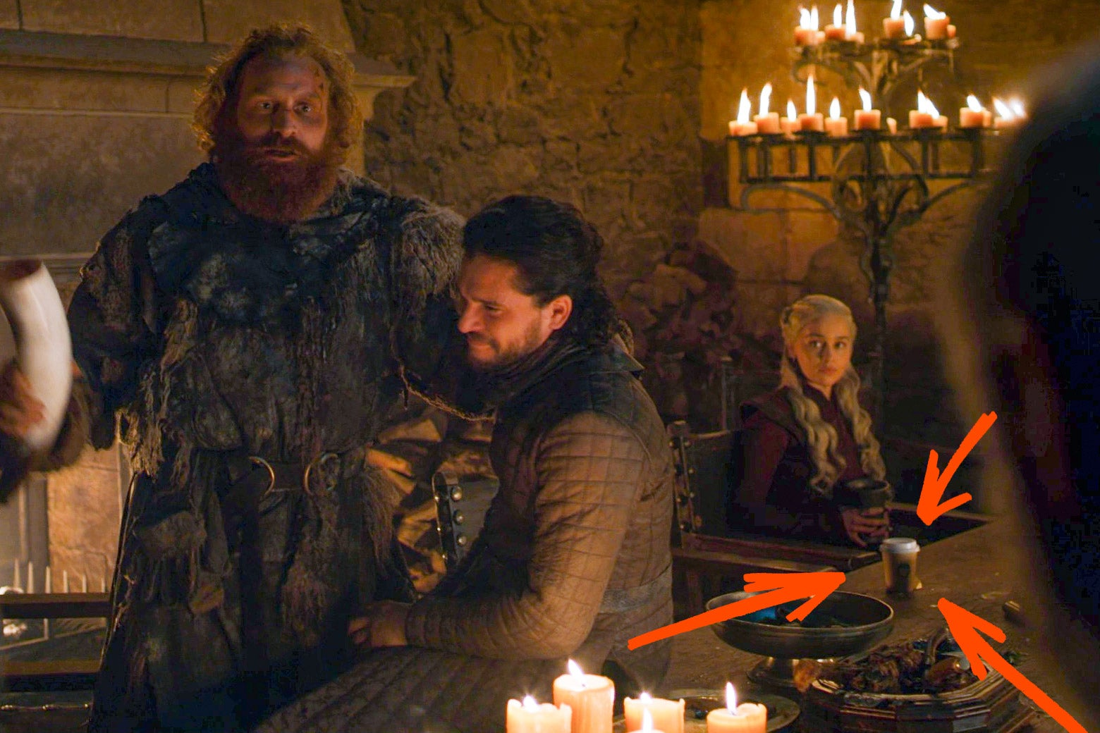 The same still from Game of Thrones Season 8 Episode 4, with red arrows pointing out the disposable coffee cup.