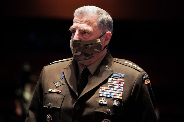 Milley wearing his uniform and a camo-patterned mask.