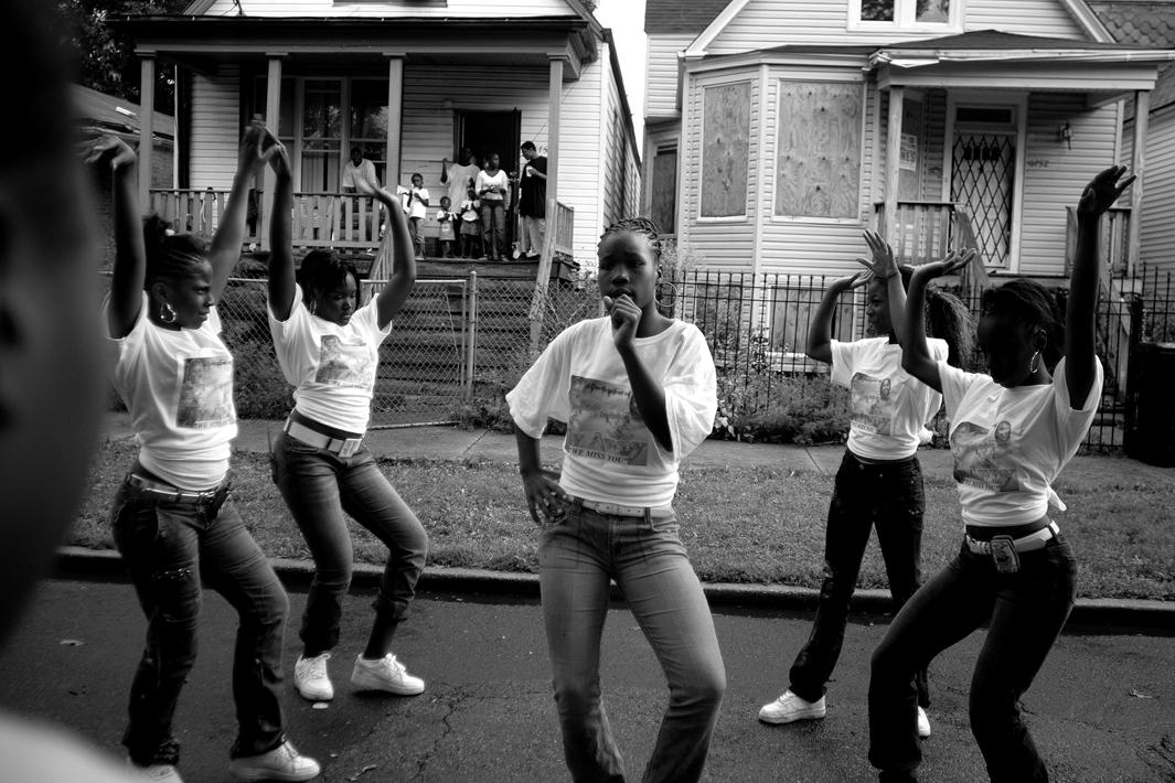 Girls in the Englewood neighborhood on Chicago's South Side attend a block party to celebrate the lives of Starkeisha Reed, 14, and Siretha White, 12. Starkeisha and Siretha were killed days apart in March 2006. The girls' mothers were friends, and both grew up on Honore Street, where the celebration took place. Englewood, Chicago, 2008.