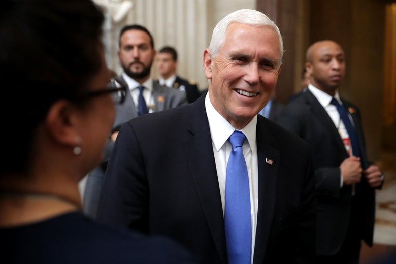 Vice President Mike Pence stops to greet and talk with tourists in the U.S. Capitol Rotunda May 14, 2019 in Washington, D.C.