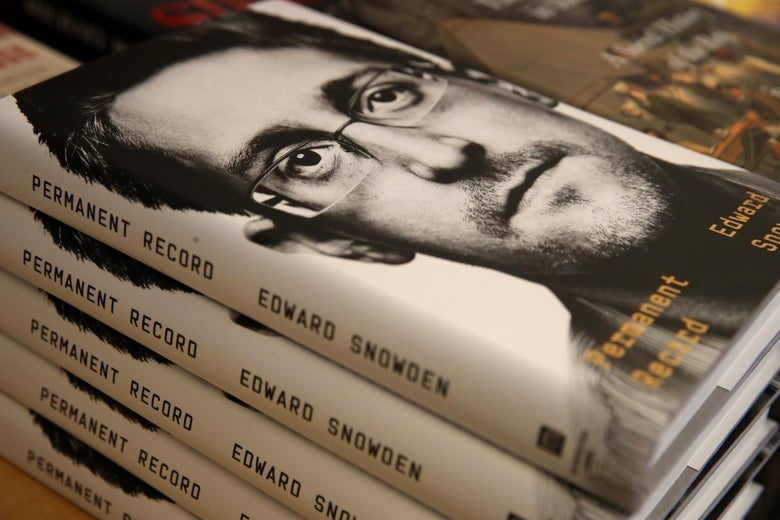 A stack of copies of the book Permanent Record by Edward Snowden.
