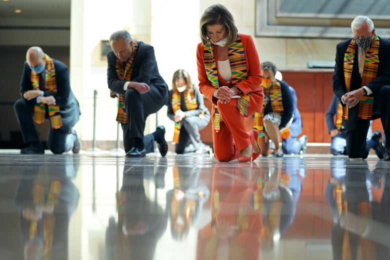 Nancy Pelosi, Chuck Schumer, and other politicians wearing masks and kente cloths take a knee.