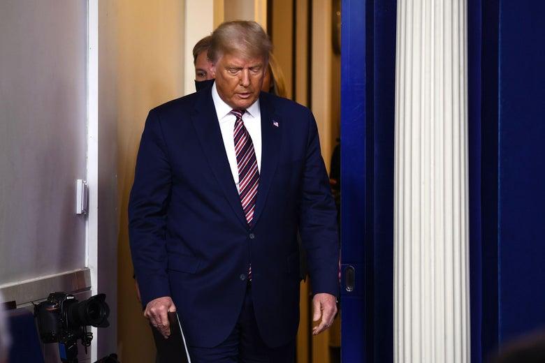 Donald Trump looks down as he walks.