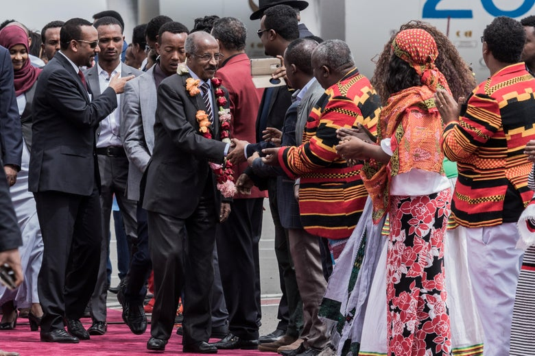Eritrean Foreign Minister Osman Saleh Mohammed walks with Ethiopian Prime Minister Abiy Ahmed as an Eritrean delegation for peace talks with Ethiopia arrives in Addis Ababa.