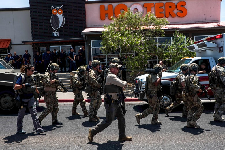 Uniformed officers on the street and outside a Hooters.