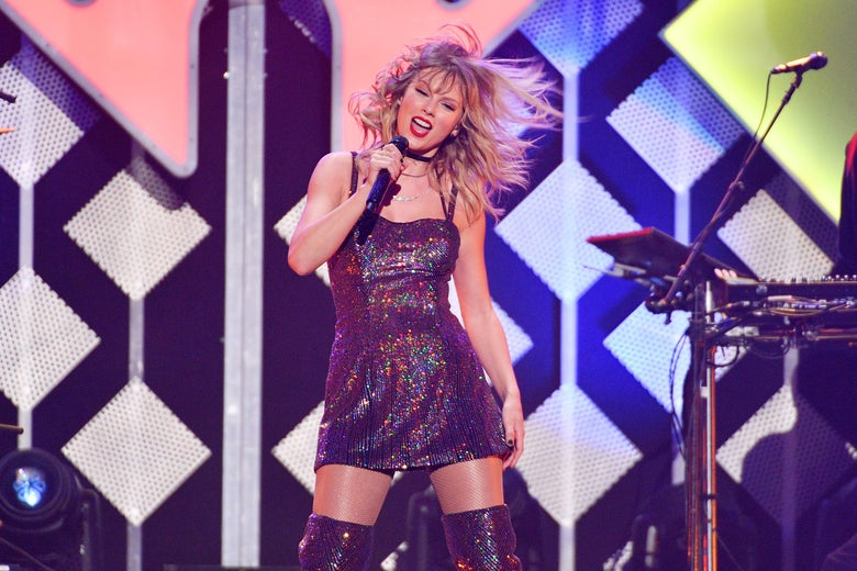 Taylor Swift whips her hair back and forth at the Jingle Ball