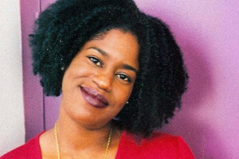 Smiling Black woman.