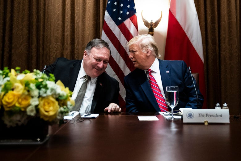 Mike Pompeo talking to Donald Trump.