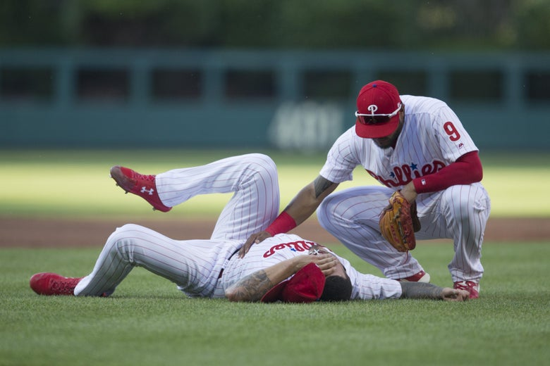 Vince Velasquez of the Philadelphia Phillies lays on the ground after being hit by a ball.