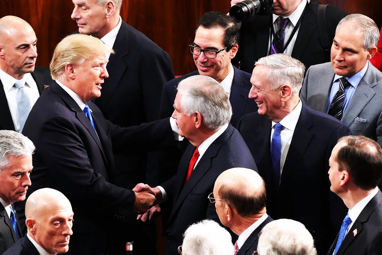 President Donald Trump talks with members of his Cabinet, including Treasury Secretary Steven Mnuchin, Secretary of State Rex Tillerson, Defense Secretary James Mattis, and EPA Administrator Scott Pruitt, following the State of the Union address in the chamber of the House of Representatives on Jan. 30 in Washington.