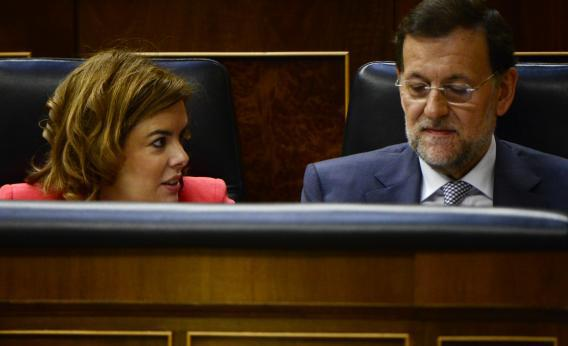 Spain's Prime Minister Mariano Rajoy (right) with first deputy prime minister, government spokeswoman, and minister of the prime minister's office Soraya Saenz de Santamaria