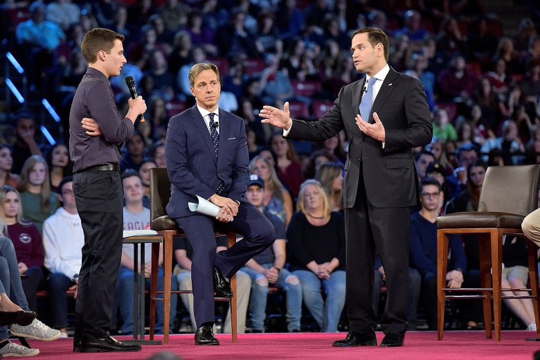 Marjory Stoneman Douglas student Cameron Kasky (L) asks Senator Marco Rubio if he will continue to accept money from the NRA during a CNN town hall meeting, at the BB&T Center, in Sunrise, Florida, U.S. February 21, 2018.