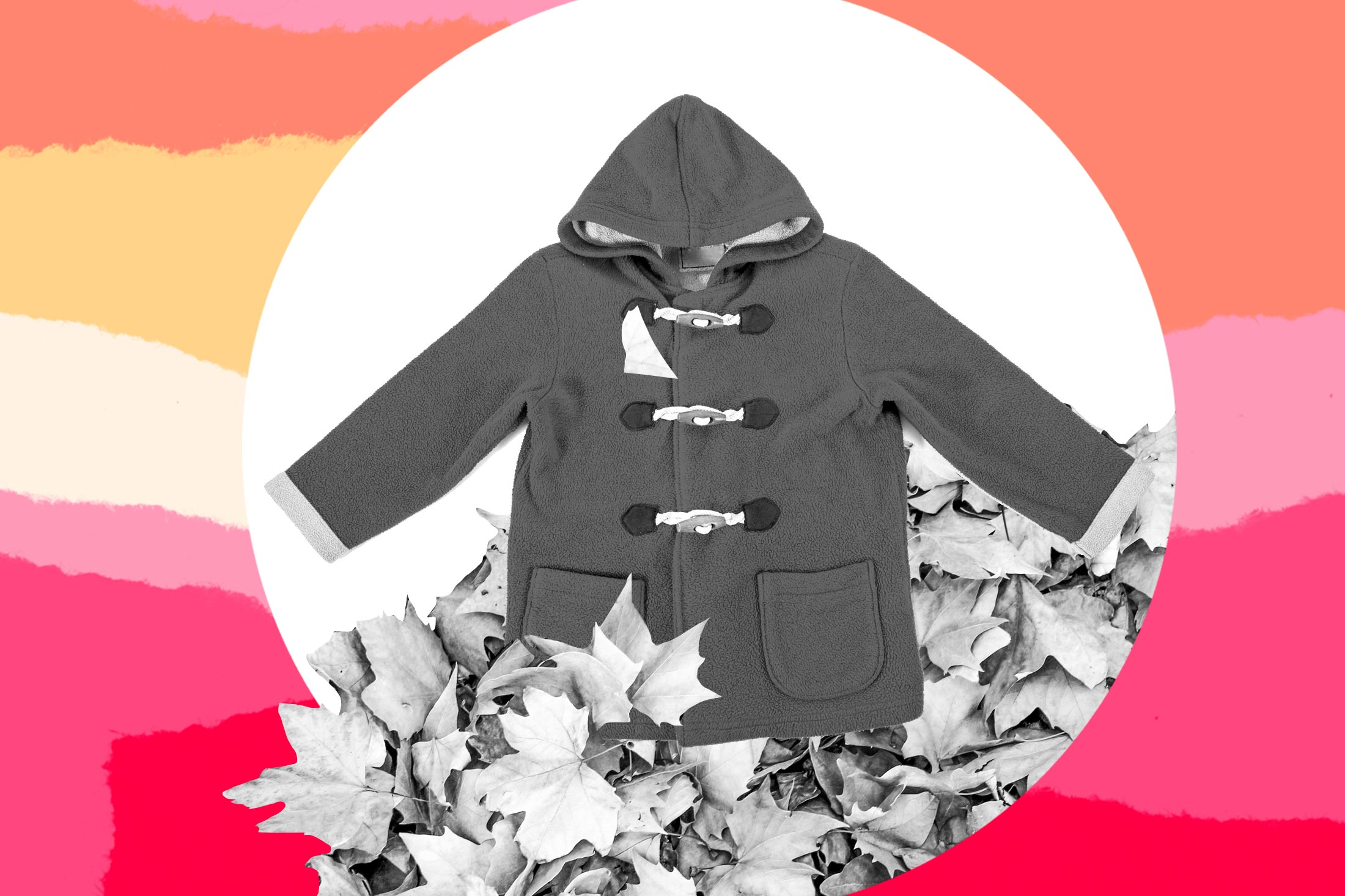 A child's coat in a pile of leaves.