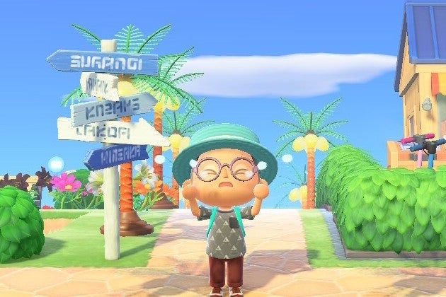 A character wearing glasses, a hat, a backpack, a gray shirt, and red pants stands by a road sign with several arrows pointing left and right. There are green bushes behind him, and a blue sky with a single white cloud above.