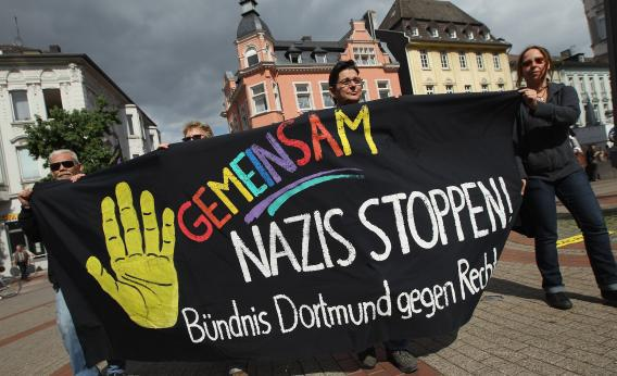 Demonstrators celebrate a court order banning a march by neo-Nazis on Sept. 1 in Dortmund, Germany.