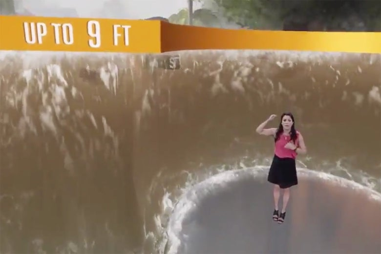 A meteorologist stands in a simulation showing what a 9-foot storm surge from Hurricane Florence would look like on a neighborhood street. The water is higher than a street sign.