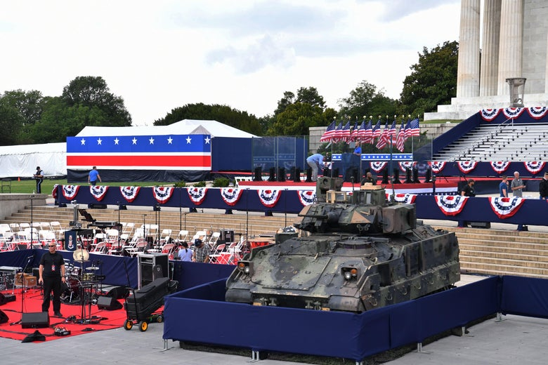 "Men are seen working next to a Bradley Fighting Vehicle as preparations are made for the ""Salute to America"" Fourth of July event at the Lincoln Memorial on the National Mall in Washington, D.C. on July 4, 2019."