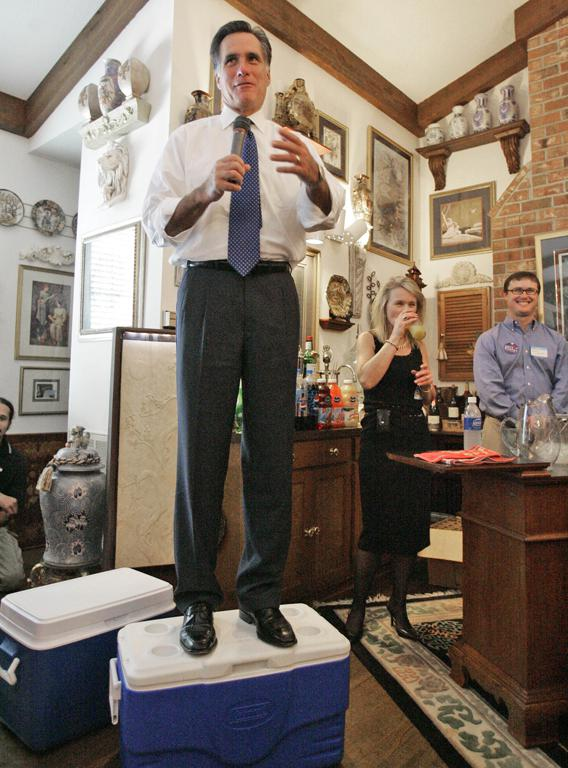 Republican Presidential hopeful Mitt Romney stands on a cooler as he talks to supporters at the private home of Dr. Jed and Mary Tepper, Thursday, Oct. 18, 2008, in Florence, S.C.