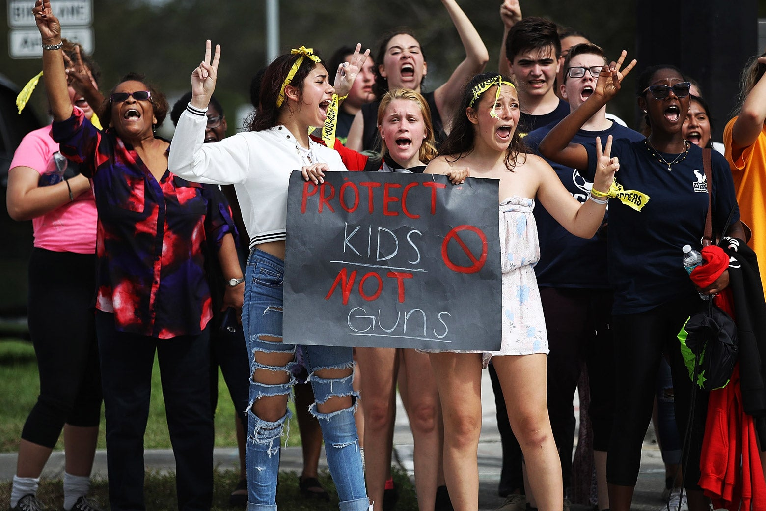 West Boca High School students arrive at Marjory Stoneman Douglas High School after walking in honor of the 17 victims of the previous week's school shooting, on Tuesday in Parkland, Florida.