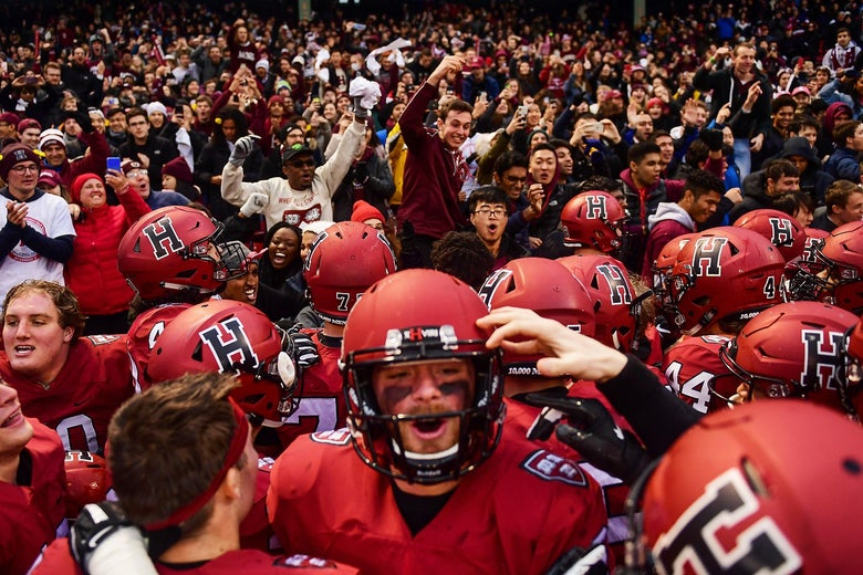 Crowd of Harvard football players and fans celebrating