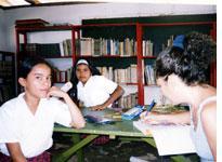 Blanca Nieves Gonzales and Isleny Alvarado Avdila, who bothgrew up in Gaviotas, with teacherTeresa Valencia