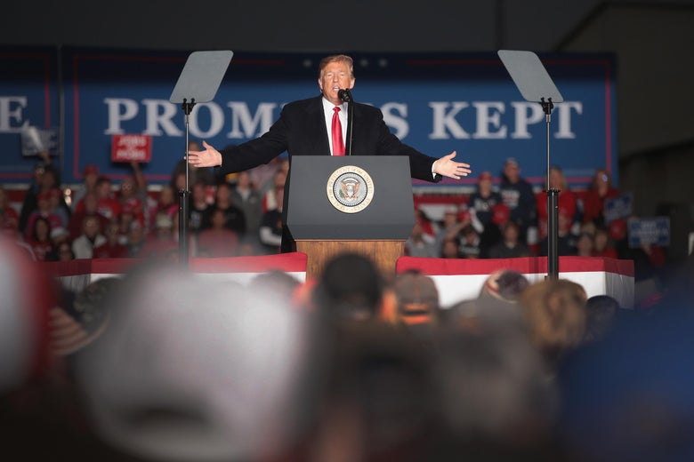 President Donald Trump at podium at a rally.