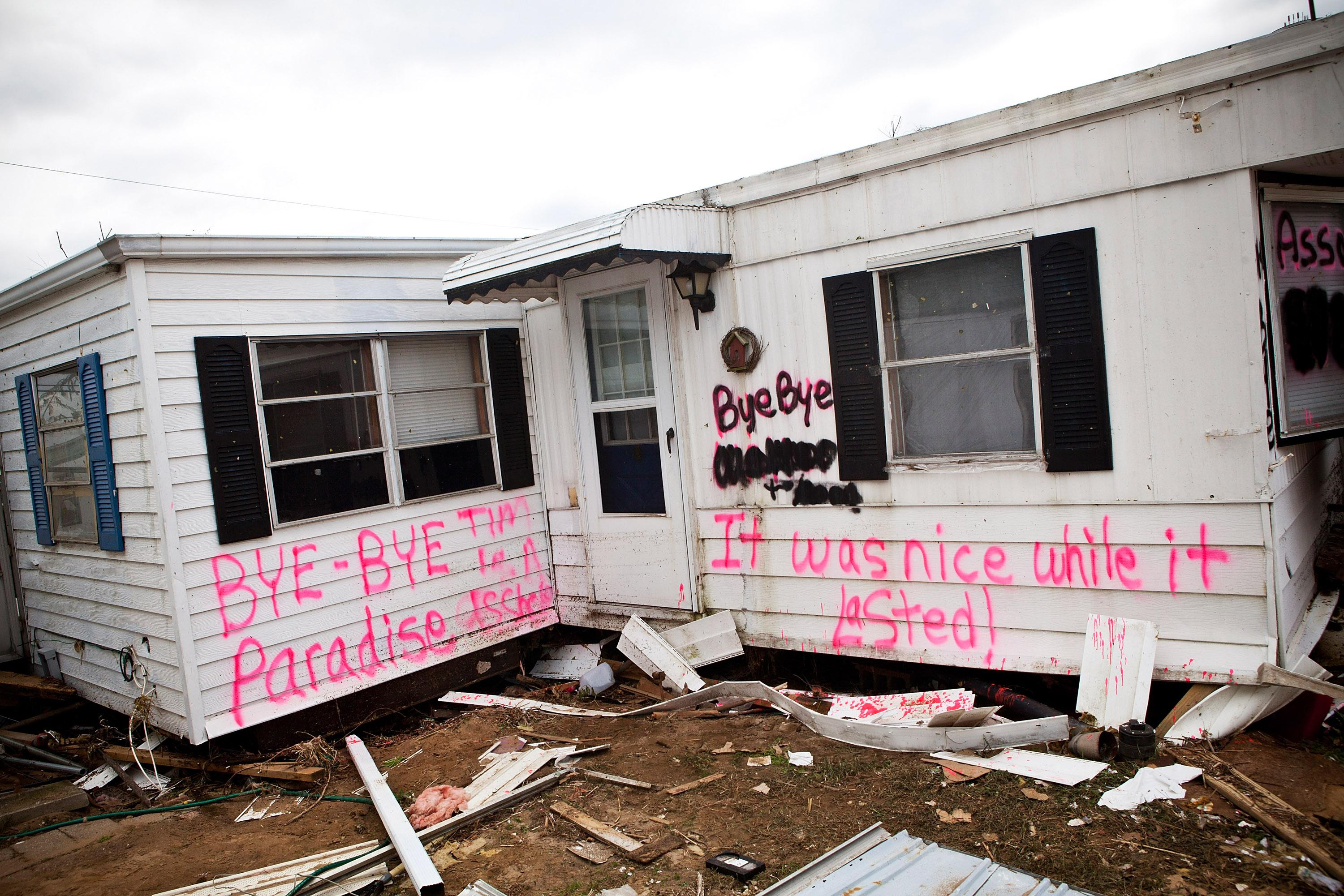 An abandoned trailer home, with the words, 'Bye-bye Paradise, it was nice while it lasted,' spray painted on its side, is seen in the Paradise Park trailer Park on November 1, 2012