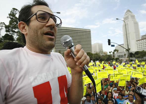 American Apparel owner Dov Charney speaks during a May Day rally protest march for immigrant rights.