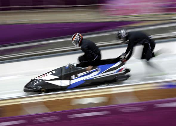 Members of the United States bobsleigh team practice ahead of the Sochi 2014 Winter Olympics at the Sanki Sliding Center on February 6, 2014 in Sochi, Russia.