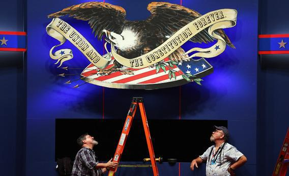 Workers put the finishing touches on the stage on Sunday for the final presidential debate.