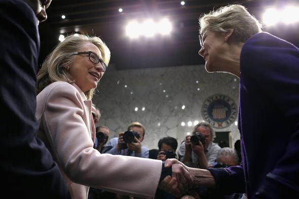 U.S. Secretary of State Hillary Clinton (L) greets Sen. Elizabet