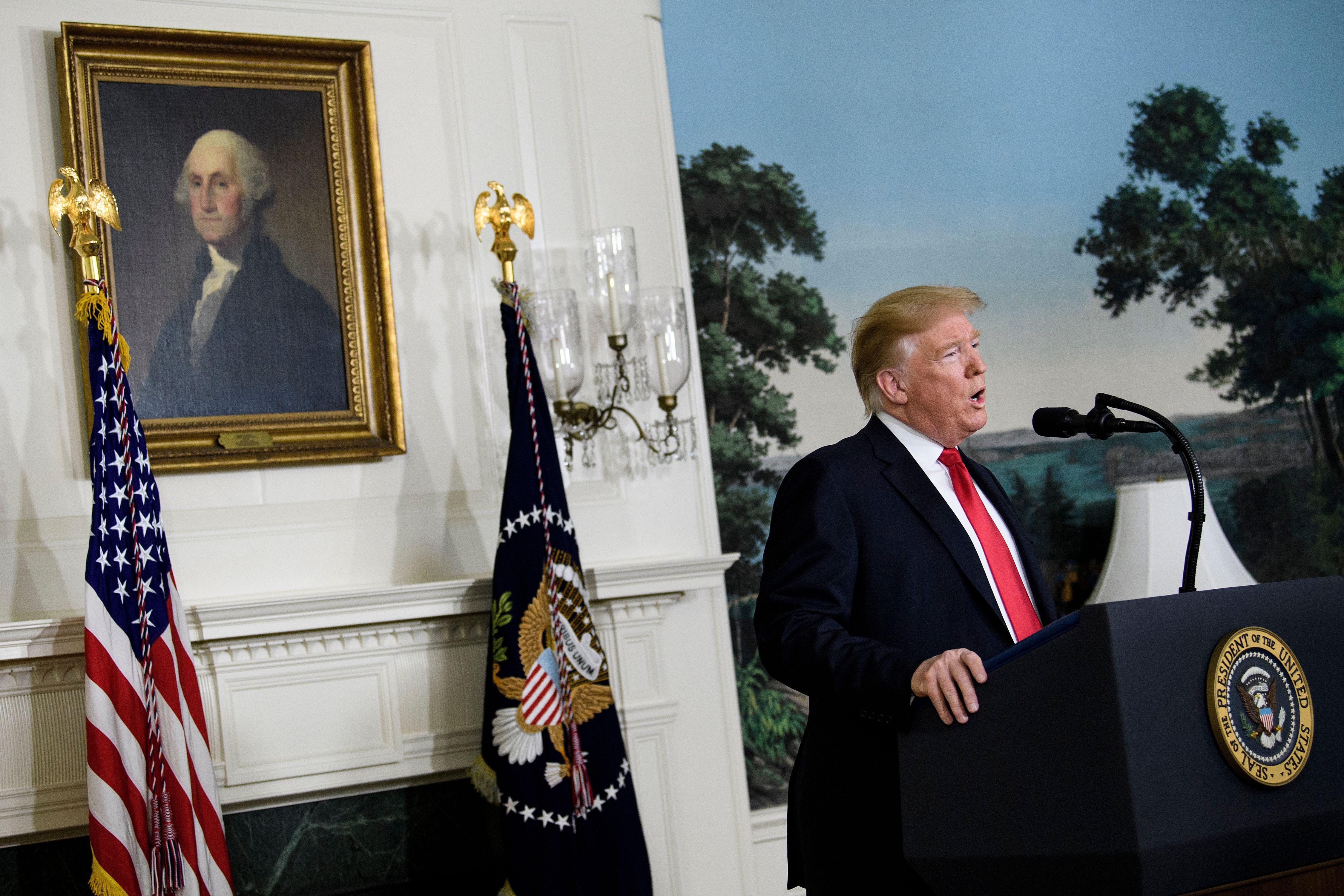 Trump speaking at a podium.