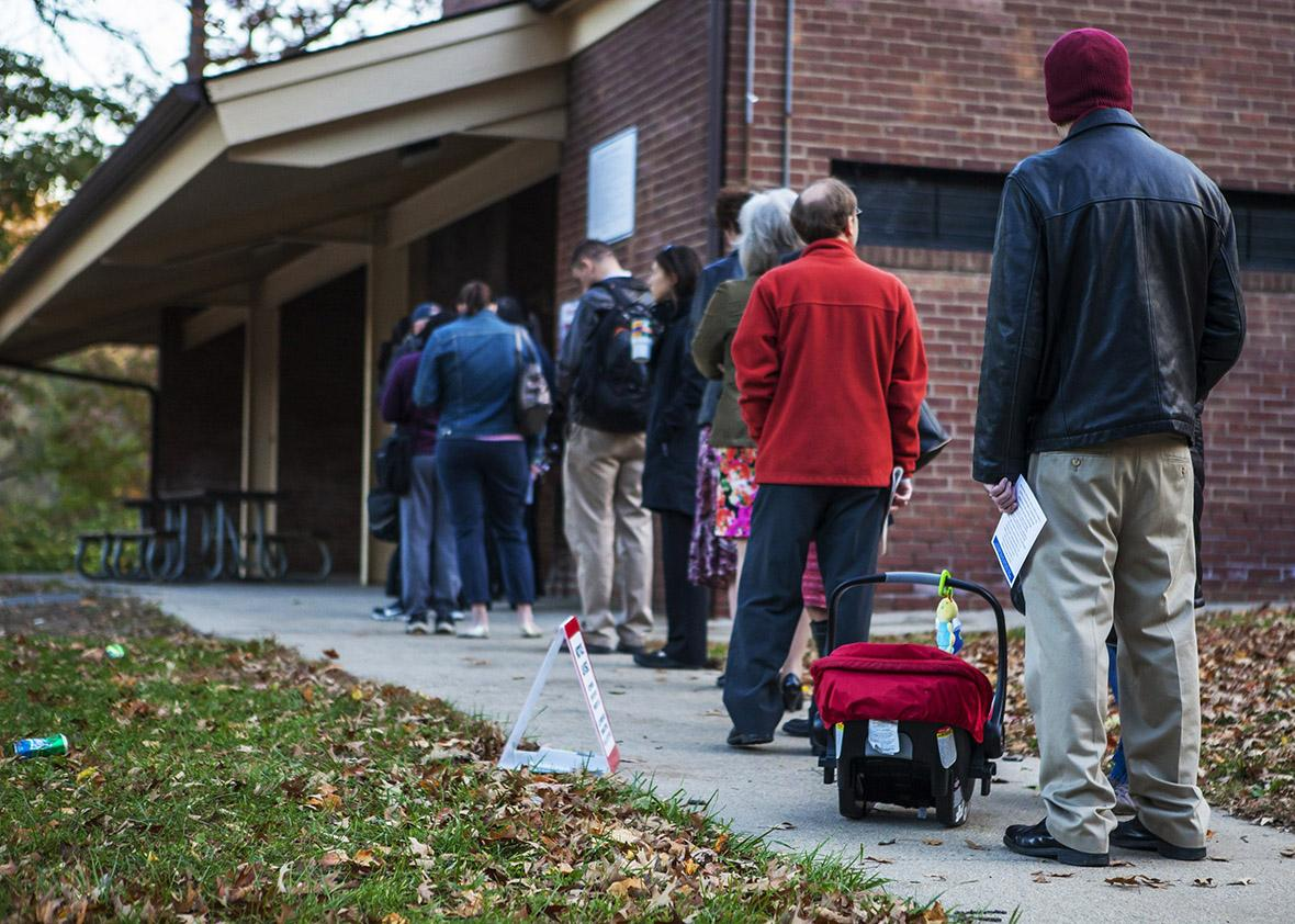 Voters line up outside a polling station to cast their ballots within US mid-term elections in Rockville, Maryland, United States on November 4, 2014.