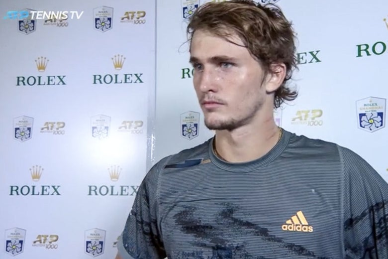 Zverev standing with his face slightly turned, showing red markings on his neck