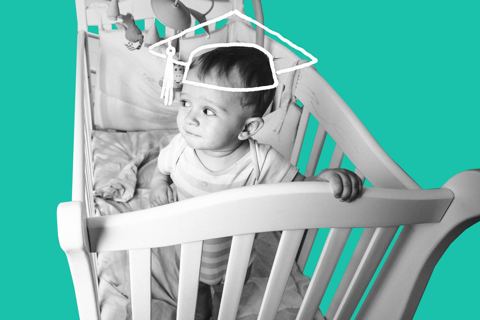 A baby in his crib, with a graduation-cap outline