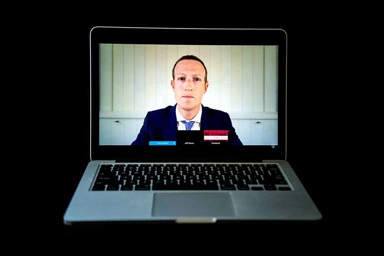 Mark Zuckerberg in a suit as seen on a laptop.