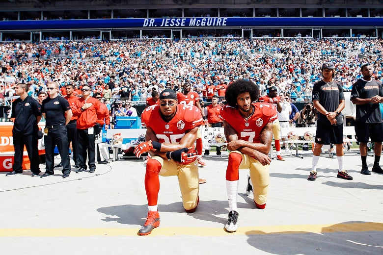 Eric Reid and Colin Kaepernick, then of the San Francisco 49ers, kneel on the sideline during the anthem, prior to a game against the Carolina Panthers on Sept. 18, 2016.