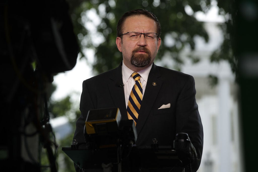 Sebastian Gorka stands facing a camera on the White House lawn.