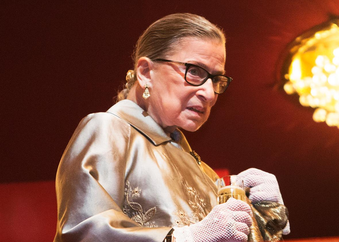 Supreme Court Justice Ruth Bader Ginsburg takes a refreshment during intermission at The Kennedy Center Honors December 6, 2015 in Washington, DC.