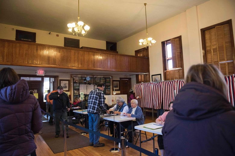 Voters cast their ballots in the U.S. presidential election at the Sutton Town Hall on Nov. 8, 2016, in Sutton, New Hampshire.