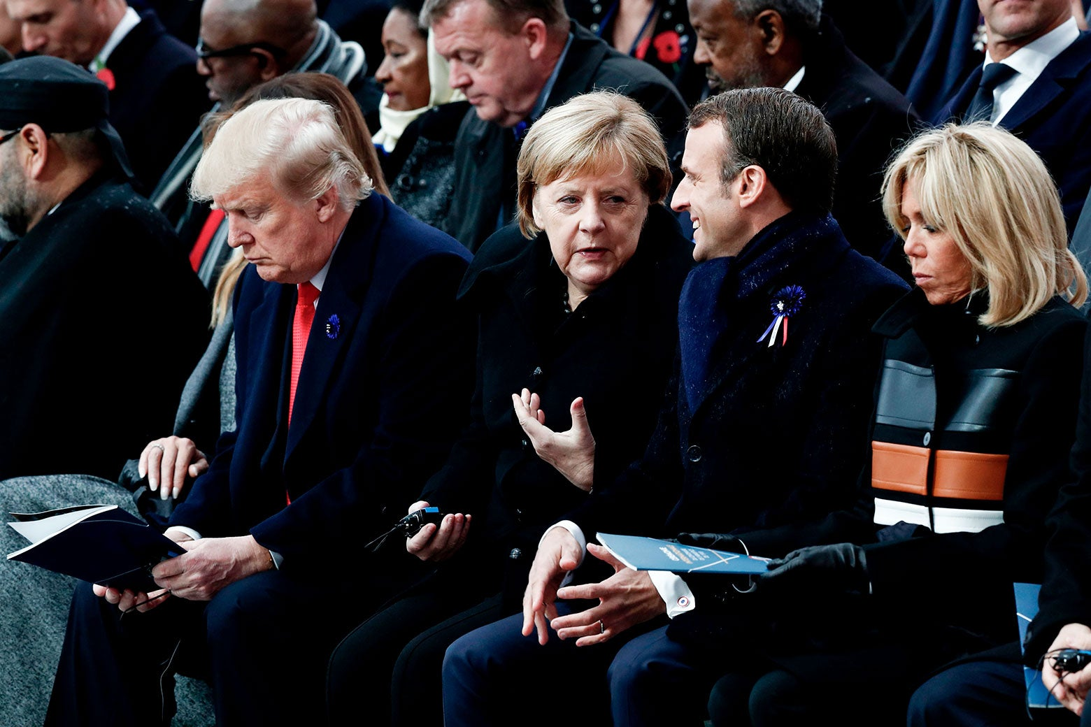 U.S. President Donald Trump, German Chancellor Angela Merkel, French President Emmanuel Macron, and his wife Brigitte Macron attend a ceremony at the Arc de Triomphe in Paris on Sunday.