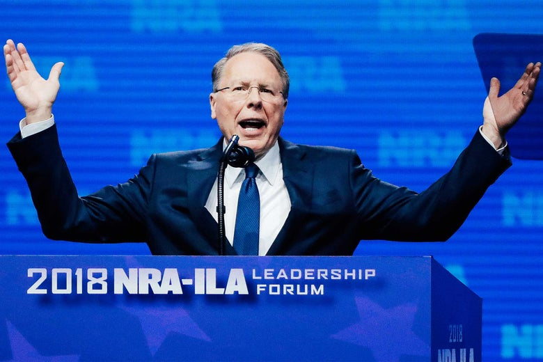 Wayne LaPierre gestures from behind a podium.
