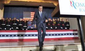 Mitt Romney arrives on the stage during a campaign rally at the Valley Forge Military Academy and College in Wayne, Pa., Friday
