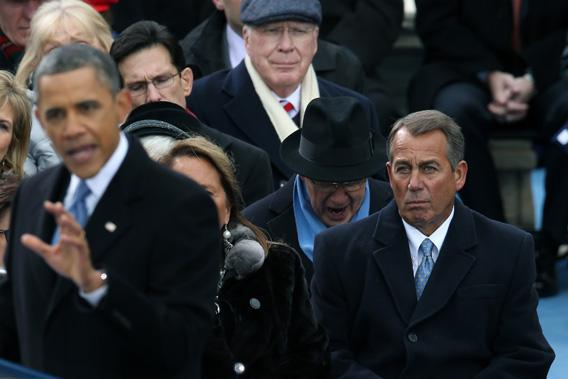 President Obama speaks as U.S. Speaker of the House Rep. John Boehner looks on during the presidential inauguration on the West Front of the U.S. Capitol, Jan. 21