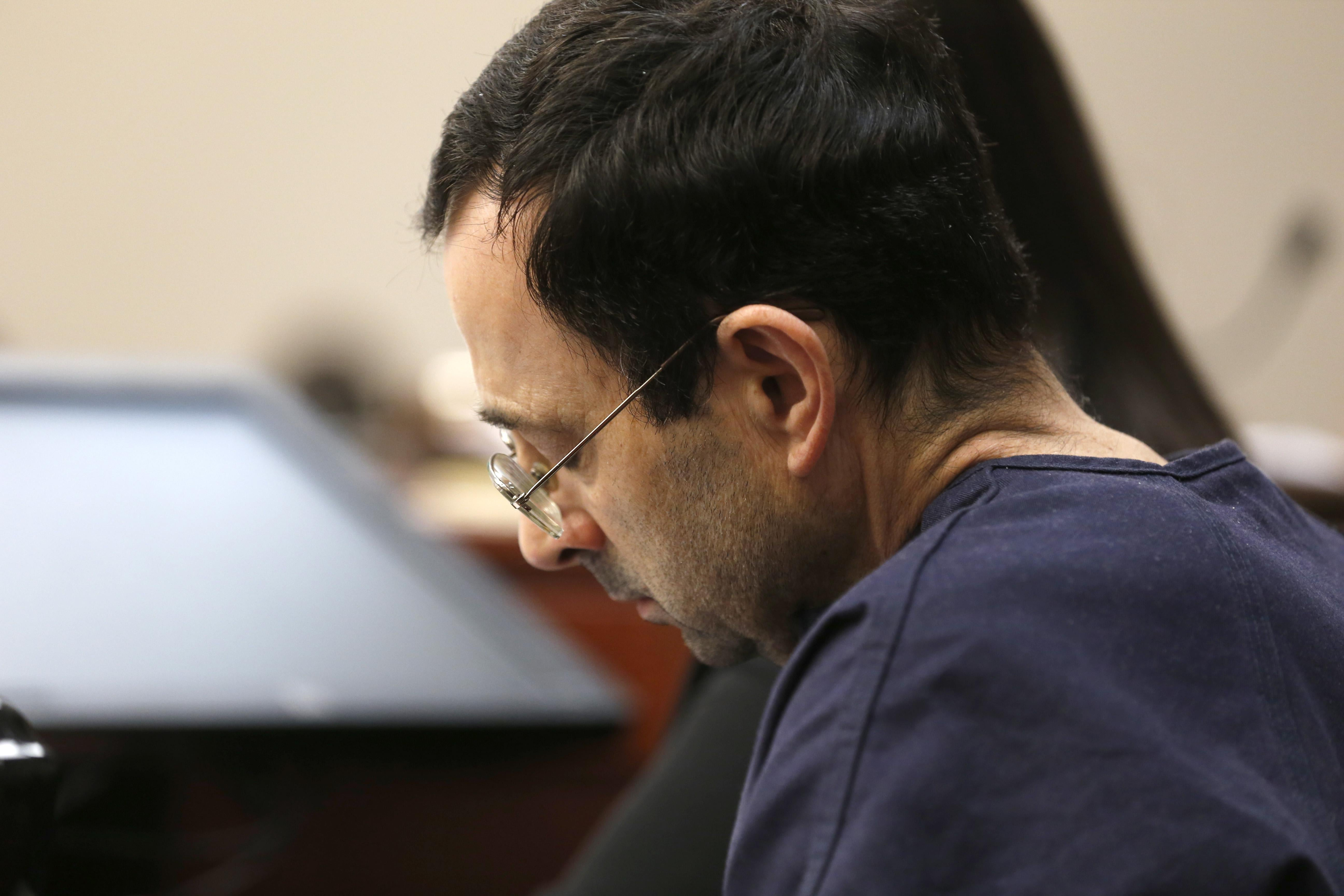 Former Michigan State University and USA Gymnastics doctor Larry Nassar listens to impact statements during the sentencing phase in Ingham County Circuit Court on January 24, 2018 in Lansing, Michigan.         More than 100 women and girls accuse Nassar of a pattern of serial abuse dating back two decades, including the Olympic gold-medal winners Simone Biles, Aly Raisman, Gabby Douglas and McKayla Maroney -- who have lashed out at top sporting officials for failing to stop him.    / AFP PHOTO / JEFF KOWALSKY        (Photo credit should read JEFF KOWALSKY/AFP/Getty Images)