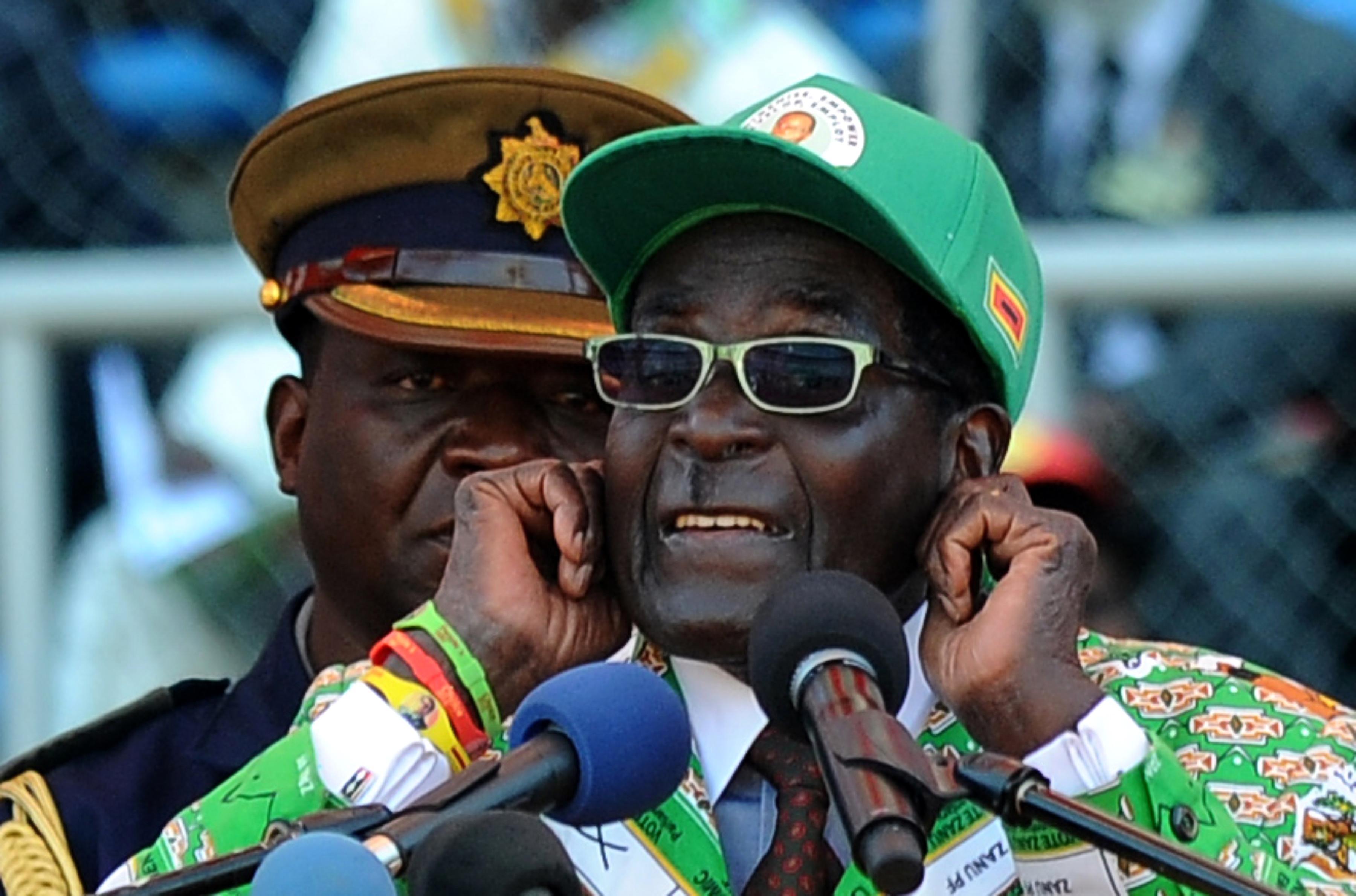 Zimbabwe President Robert Mugabe vows to behead gays.
